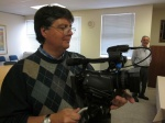 Cameraman & editor Mike Van Ryneveld with client Gerald Kleinman looking on