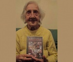 Doris holds her Life Story DVD - a proud and special moment